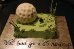 golf ball on green cake
