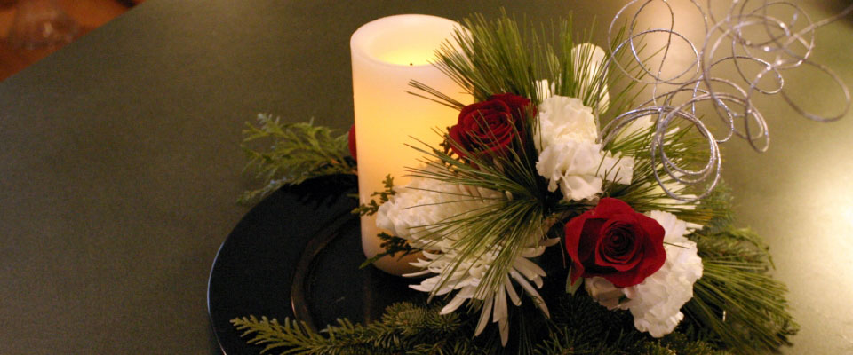 winter roses with battery operated candle