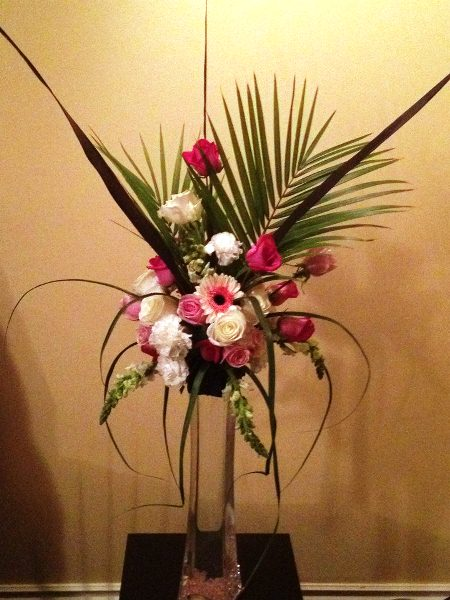 clear vase centerpiece with spikes