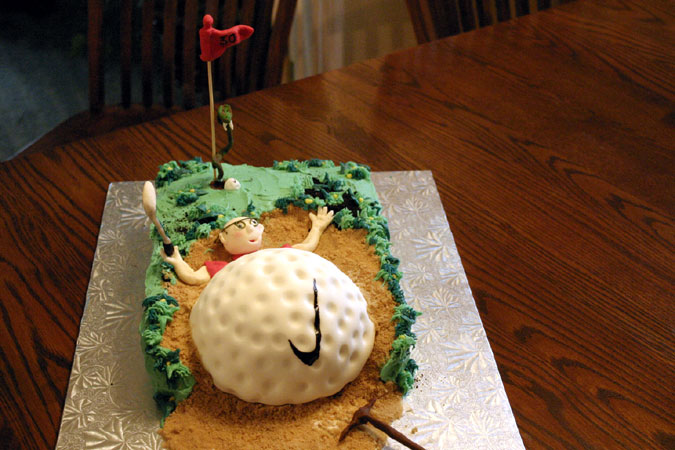 man crushed by golfball cake