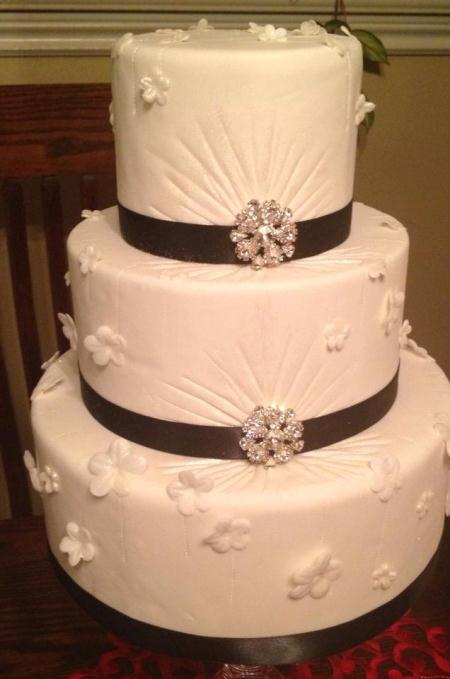 3 tier fondant with black ribbon and bling broaches