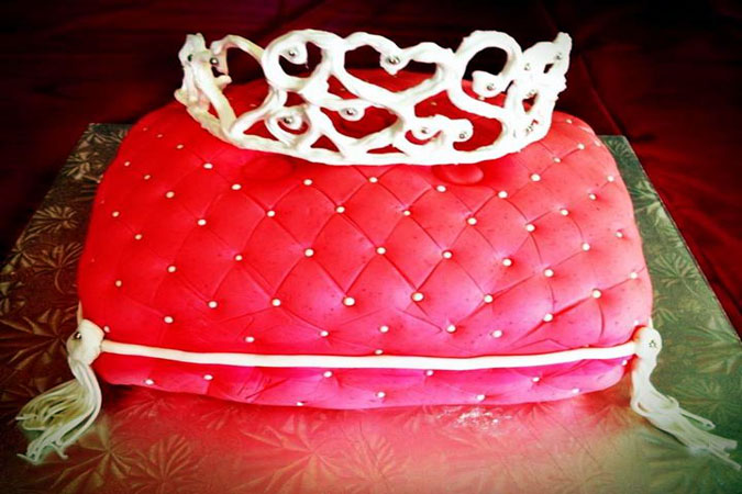 pink pillow and tiara cake