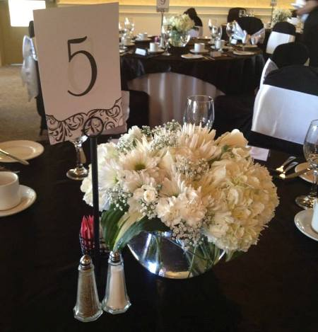 small assorted white floral centerpiece