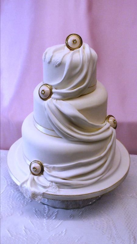 3 tier with fondant sash and buttons