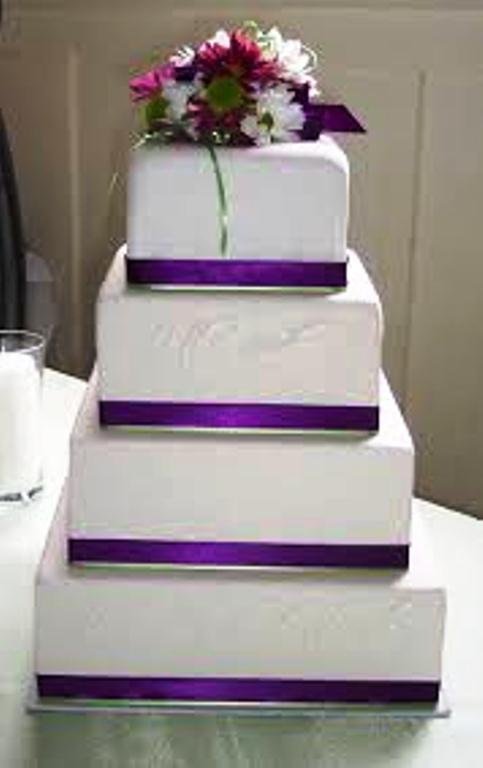 4 Tier Wedding Cake With Purple Ribbon