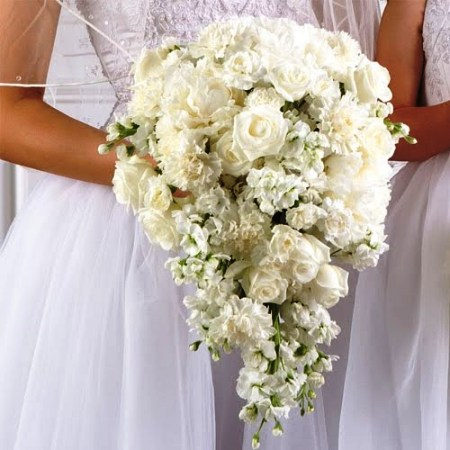 flowing white rose assorted floral bouquet